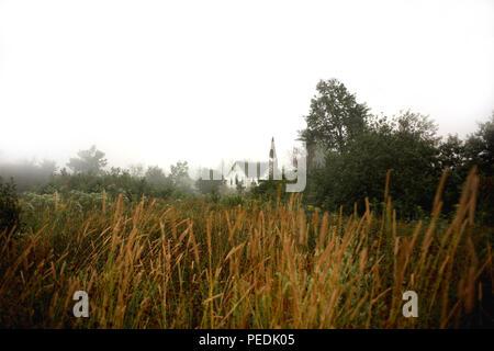Rural Church in Fog - Stock Image