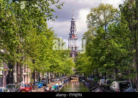 Westerkerke Church in Amsterdam viewed along the Prinsengracht Canal, Amsterdam, Netherlands - Stock Image