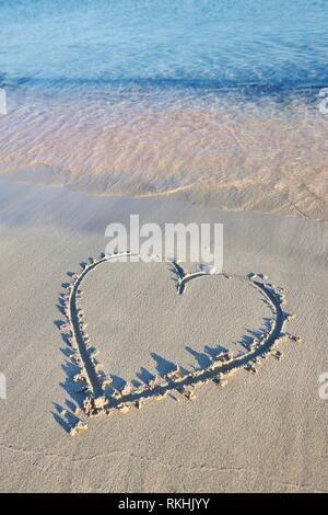 Heart paintet in sand, Elafonisi beach, Crete, Greece - Stock Image