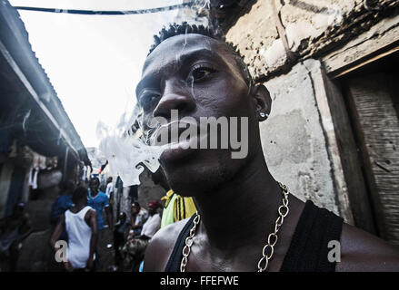 Smoking a joint in Freetown, Sierra Leone - Stock Image