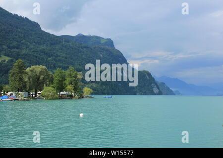 Beautiful camping place at the shore of Lake Brienz, Switzerland. - Stock Image