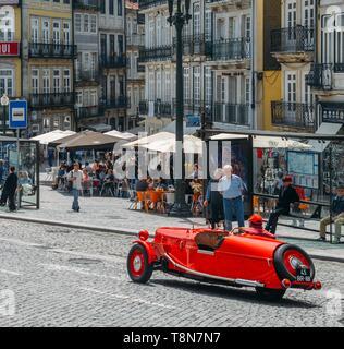 Porto, Portugal - April 29, 2019: Vintage red car in the historic centre of Porto, Portugal - Stock Image