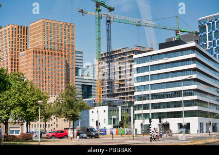 The Zuidas is a business district in Amsterdam. New residential towers arise. - Stock Image