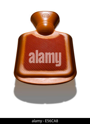 A an orange hot water bottle with strong shadow below - Stock Image