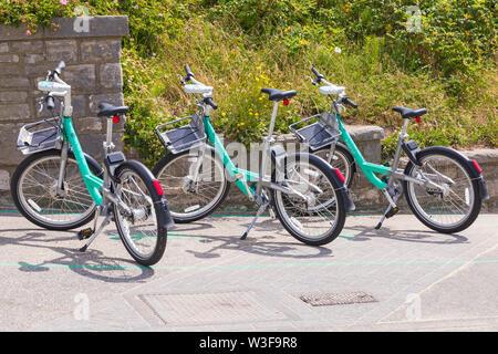 Beryl Bikes in bay at Boscombe, Bournemouth, Dorset UK in July - Stock Image