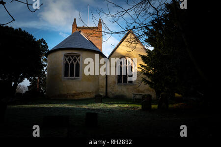 English village church in early morning sunlight - Stock Image