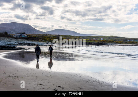 Ardara, County Donegal, Ireland. 31st March 2019. People taking a walk on the beach on a warm but overcast day with sunny spells. Credit: Richard Wayman/Alamy Live News - Stock Image