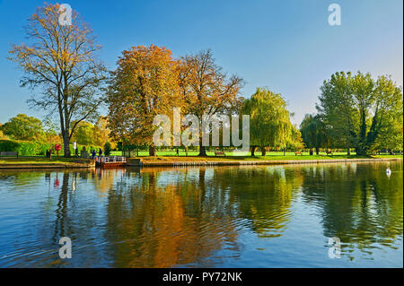 Stratford upon Avon, Warwickshire and the old chain ferry is crossing the River Avon on an autumnal afternoon - Stock Image