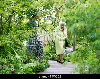 Queen Elizabeth II is shown around the 'Back to Nature' by the designer, The Duchess of Cambridge during their visit to the RHS Chelsea Flower Show at the Royal Hospital Chelsea, London. - Stock Image