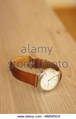 Timex men watch with leather belt on a wooden table - Stock Image