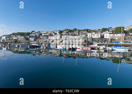 Newlyn, Cornwall, UK. 3rd May 2019. UK Weather. A chilly start to the morning, but once the sun came out the temperature rose to 12 degrees C early this morning at Newlyn harbour, with the boats and houses of the village reflecting in the calm habour waters. Credit Simon Maycock / Alamy Live News - Stock Image
