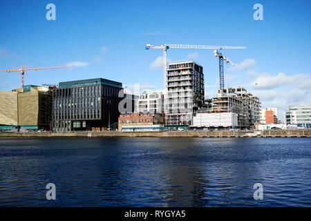 cranes and new office developments at dublin landings in the docklands waterfront river liffey Dublin Republic of Ireland europe - Stock Image