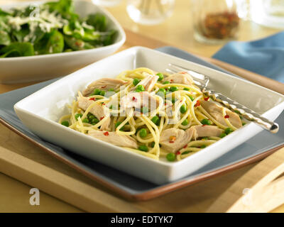 Pasta with Chicken and Peas - Stock Image