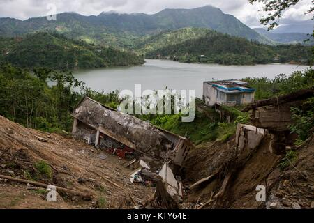 Damaged homes in the aftermath of Hurricane Maria December 15, 2017 in Utuado, Puerto Rico. - Stock Image