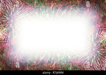 Colorful fireworks with white rectangle soft glowing edges copy space in the middle - Stock Image