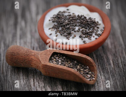 Yogurt with chia seeds, a combination of nutritious breakfast - Stock Image