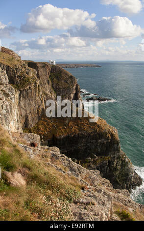 The Wales Coastal Path in North Wales. Picturesque view of the RSPB Ellin's Tower on the south coast of Holy Island. - Stock Image