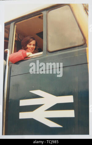 Young woman in British Rail train in the 1960s/70s, England, UK - Stock Image