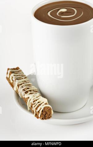 Cup of drinking chocolate with chocolate bar. Studio shot.        Ref: CRB538_103609_0006  COMPULSORY CREDIT: Martin Harvey / Photoshot - Stock Image