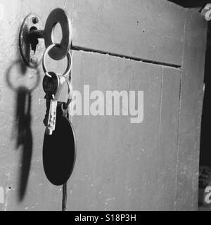 Key in a door - Stock Image