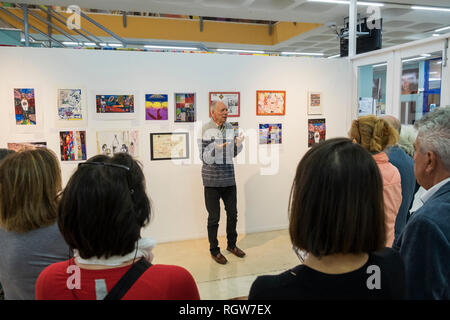 Marc Kuhn talking about the artworks at the opening of the exhibition '50 years of Col Art' in the Adeje Cultural Center, 11th January 2019. Tenerife, - Stock Image