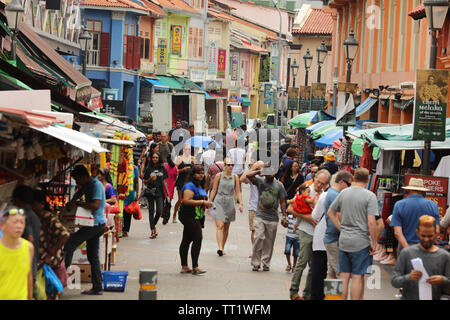 Busy popular shopping street with small shops in the Indian ethnic district of Little India or Tekka of the city state of Singapore. - Stock Image