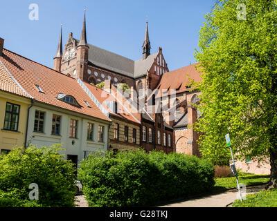 St. Georgen church, seen from park area at Fuerstenhof, Wismar, Mecklenburg-Vorpommern, Germany - Stock Image