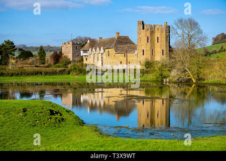 Stokesay Castle, Shropshire, UK. Photo showing reflection in pond, taken from public footpath. - Stock Image