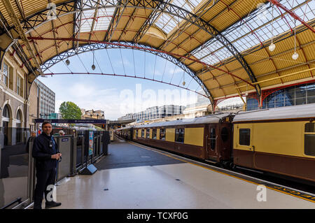 Pullman carriages forming the Belmond Venice Simplon Orient Express stand at Platform 2 VIctoria Sation, London SW1 awaiting departure - Stock Image