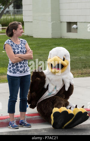 Anchorage, Alaska. 4th July, 2018. A person in a giant bald eagle costume rests before the start of the annual Independence Day parade and celebration July 4, 2018 in Anchorage, Alaska. Credit: Planetpix/Alamy Live News - Stock Image