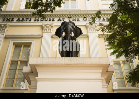 Bronze elephant statue sits in front of the Arts House at the Old Parliament House in the Colonial District, Singapore - Stock Image