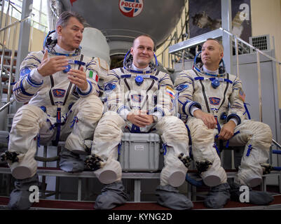Expedition 52 flight engineers Paolo Nespoli of ESA, left, Sergey Ryazanskiy of Roscosmos, and Randy Bresnik of - Stock Image