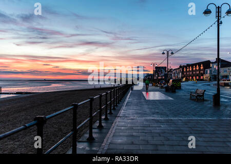 Cleethorpes, Lincolnshire, UK. 31st Dec, 2018. UK Weather: Red sunrise skies in Cleethorpes, Lincolnshire, East Coast, UK. 31st Dec, 2018. Red sky making the perfect backdrop to Cleethorpes Leisure Centre and promenade with partial cloud. Credit: Tommy (Louth)/Alamy Live News - Stock Image
