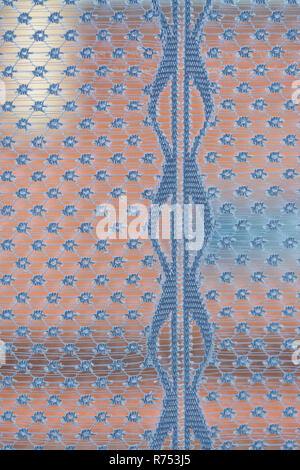 Dreamy look through a window with curtain detail. Abstract view via airy sheer decoration from lace net. Vertical line and spotted pattern background. - Stock Image