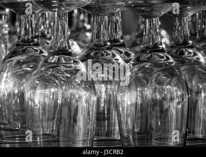 Reflection patterns on upside down water goblets monochrome - Stock Image