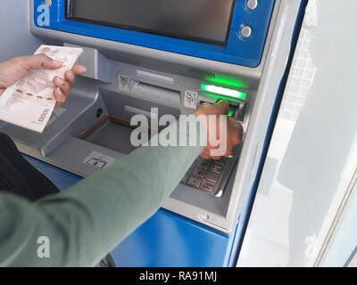 withdraw money from ATMs - Stock Image