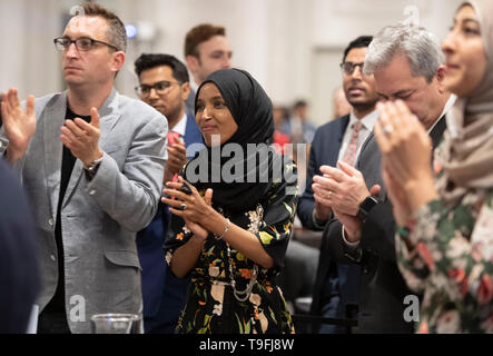 Congresswoman Ilhan Omar of Minnesota's 5th Congressional District stands and applauds a speaker at the annual city-wide iftar dinner in Austin, Texas, in honor of the 14th day of Ramadan.Omar was the event's featured speaker. - Stock Image