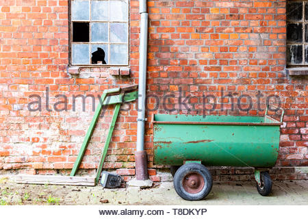 Niedersachsen, Germany. Exterior of a farmhouse stable with a small fluid or septic tank. - Stock Image