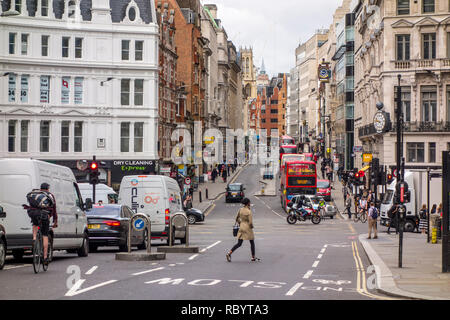 People on Ludgate Hill, looking towards Ludgate Circus and Fleet Street, City of London, UK - Stock Image