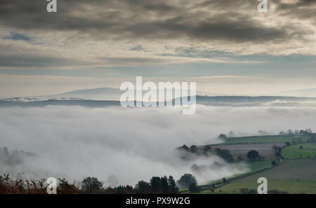 Ape Dale full of mist with Wenlock Edge just poking through, seen from Ragleth Hill, Church Stretton, Shropshire - Stock Image