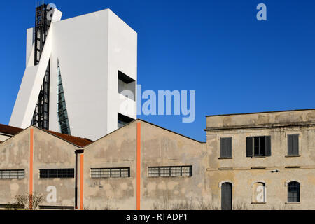 The Fondazione Prada complex seen from the new Adriano Olivetti square, in the Symbiosis district. On the left, the new Tower building can be seen - Stock Image