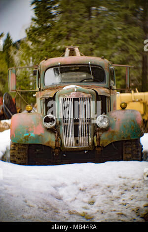 A 1942 White Super Power 2 1/2 ton winch truck in a wooded area, in Noxon, Montana  This image was shot with an antique Petzval lens and will show sig - Stock Image