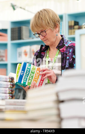 Hay Festival, Hay on Wye, Powys, Wales, UK - Friday 31st May 2019 - A visitor to the Festival bookshop takes a look at the new book by author John Boyne.  The eleven day Festival features over 800 events many aimed at children - the Hay Festival continues to Sunday 2nd June. Photo Steven May / Alamy Live News - Stock Image