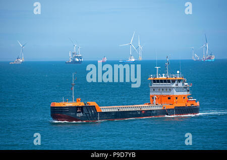 The Motor hopper vessel operating on the new harbour on the South side of Greyhope lighthouse near Aberdeen city, Scotland. Grampian Region. United Ki. - Stock Image