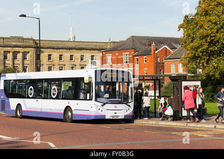 Passengers ready to board the 501 service at stop BB on Black Horse Street, Bolton, adjacent to Moor Lane bus station. - Stock Image