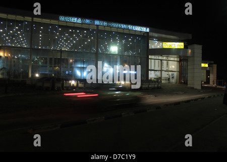 A car drive by the remodeled domestic terminal of Murtala Muhammed Airport, Ikeja-Lagos  at night. - Stock Image
