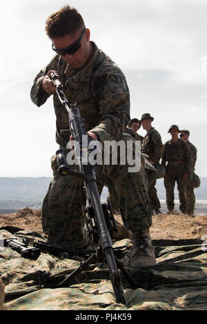 U.S. Marine Corps Lance Cpl. Nathan A. Duffel, an anti-tank missile gunner with 1st Tank Battalion, disassembles a M240B machine gun during the 1st Marine Division (MARDIV) Super Squad Competition at Marine Corps Base Camp Pendleton, California, Aug. 28, 2018. The competition tests the Marines in a broad spectrum of infantry related skills to include offensive and defensive operations, patrolling techniques, and combat marksmanship, to determine the best squad within 1st MARDIV. (U.S. Marine Corps photo by Cpl. Robert G. Gavaldon) - Stock Image