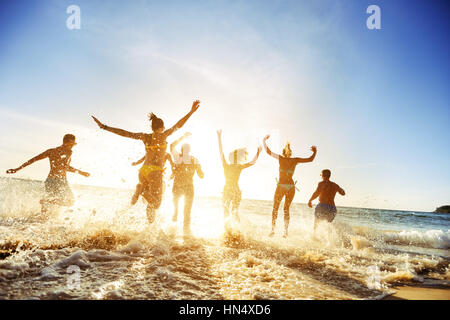 Crowd people friends sunset beach holidays - Stock Image