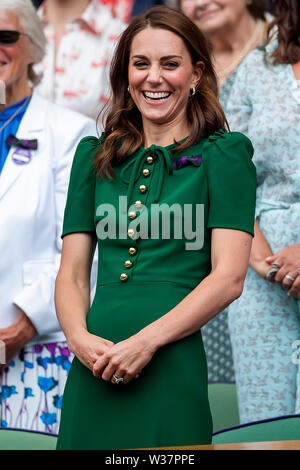 London, UK. 13th July, 2019.London, UK. 13th July, 2019. The All England Lawn Tennis and Croquet Club, Wimbledon, England, Wimbledon Tennis Tournament, Day 12; Catherine Duchess of Cambridge looks laughs as Simona Halep (ROM) is interviewed Credit: Action Plus Sports Images/Alamy Live News Credit: Action Plus Sports Images/Alamy Live News - Stock Image