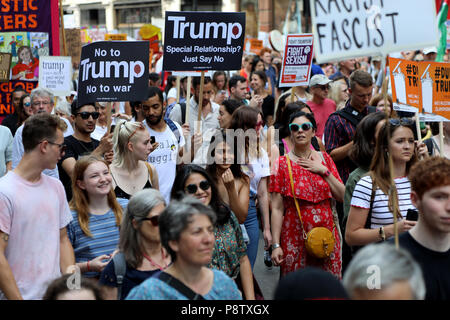 London, UK – July 13, 2018: Demonstrators march down Regent Street in central London to protest against US president Donald Trump, during his visit to the country Credit: Dominic Dudley/Alamy Live News - Stock Image